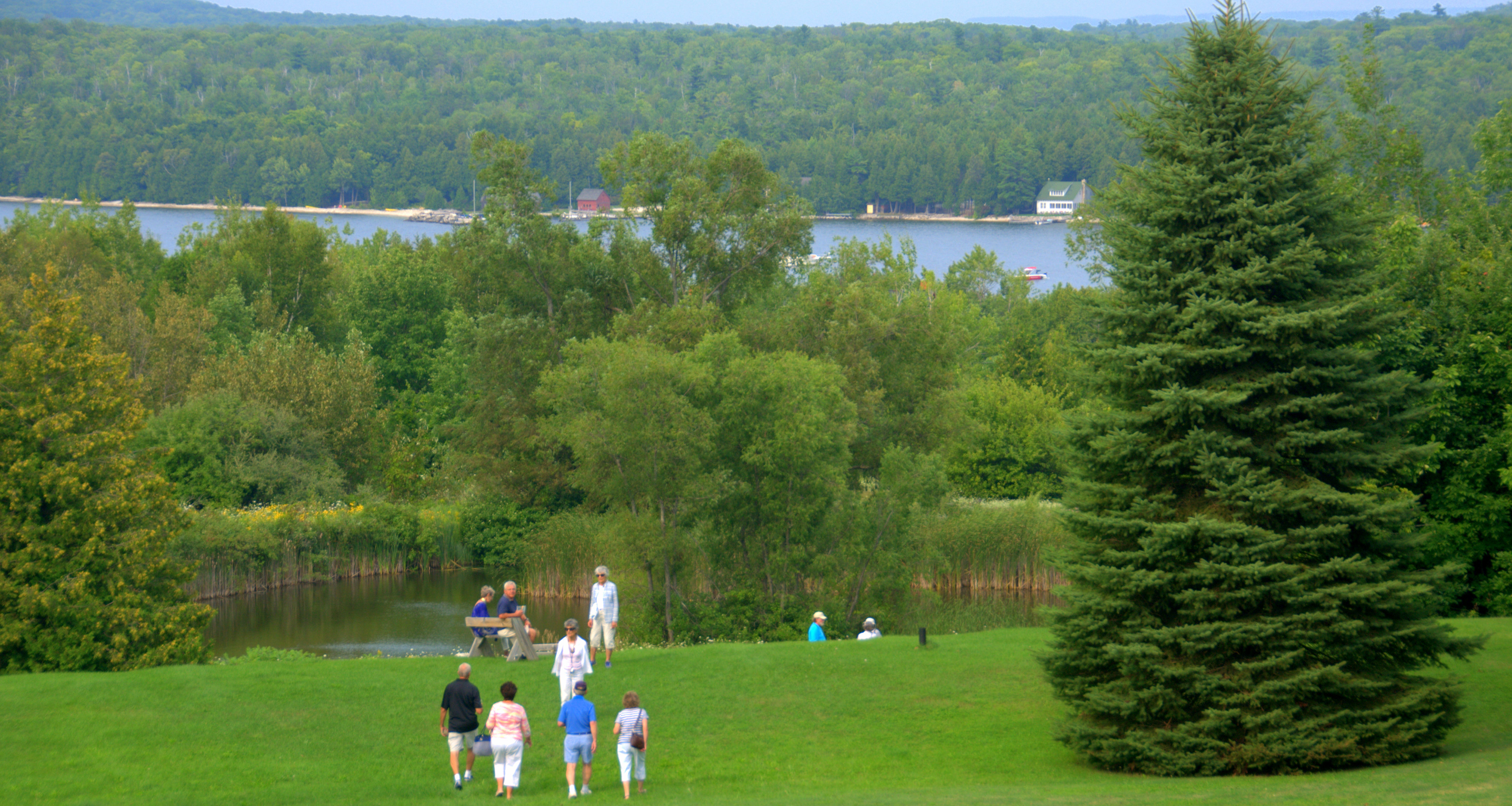 Guests stroll through the Grnad View Park during Annual Gathering.  Photo by David Harsh